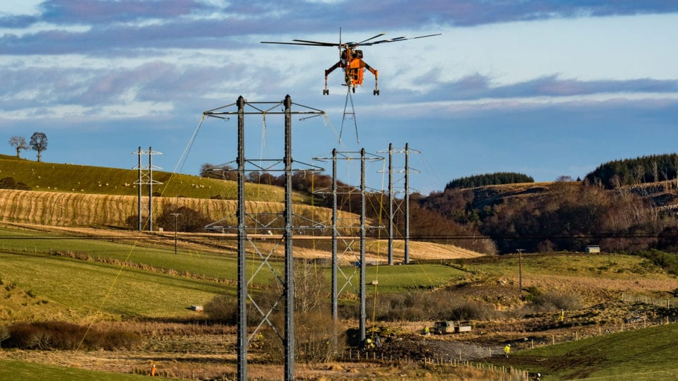 Helicopter used to install composite power poles